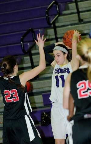 Westhill's Megan D'Alessandro (11) looks to pass as New Canaan's Georgia Hunsinger (23) defends during the girls basketball game at Westhill High School in Stamford on Tuesday, Feb. 12, 2013. Photo: Amy Mortensen / Connecticut Post Freelance