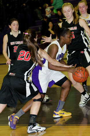 Westhill's Tyler Evans (20) cuts through New Canaan defenders during the girls basketball game against New Canaan at Westhill High School in Stamford on Tuesday, Feb. 12, 2013. Photo: Amy Mortensen / Connecticut Post Freelance