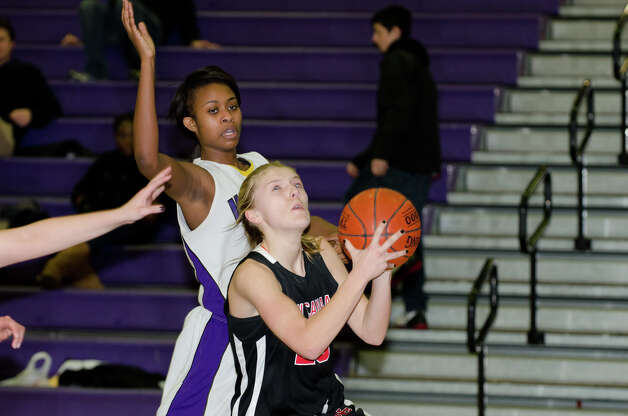 New Canaan's Kelly Armstrong (25) goes up for a shot as Westhill's Krystal Dixon (30) defends during the girls basketball game at Westhill High School in Stamford on Tuesday, Feb. 12, 2013. Photo: Amy Mortensen / Connecticut Post Freelance