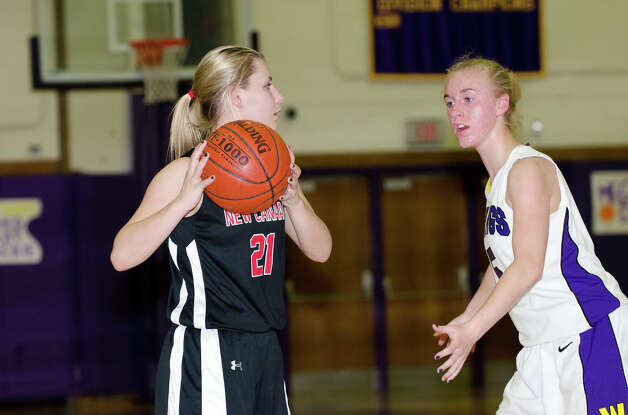 New Canaan's Courtney Rogers (21) ontrols the ball as Westhill's Steph Roones (5) defends during the girls basketball game at Westhill High School in Stamford on Tuesday, Feb. 12, 2013. Photo: Amy Mortensen / Connecticut Post Freelance