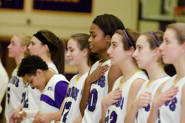 The Westhill High School girls basketball team stands for the National Anthem during the girls basketball game against New Canaan at Westhill High School in Stamford on Tuesday, Feb. 12, 2013. Photo: Amy Mortensen / Connecticut Post Freelance