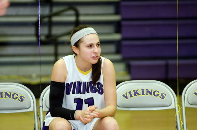 Westhill's Megan D'Alessandro (11) waits for her name to be announced as the starting line up is read during the girls basketball game against New Canaan at Westhill High School in Stamford on Tuesday, Feb. 12, 2013. Photo: Amy Mortensen / Connecticut Post Freelance