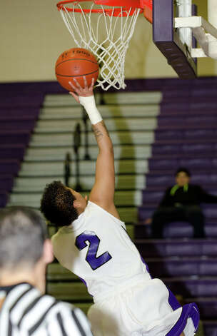 Westhill's Jineida Harkness (2) goes up for a shot during the girls basketball game against New Canaan at Westhill High School in Stamford on Tuesday, Feb. 12, 2013. Photo: Amy Mortensen / Connecticut Post Freelance