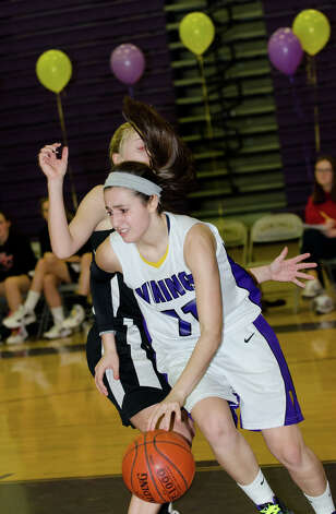 Westhill's Megan D'Alessandro (11) speeds around New Canaan's Kelly Armstrong (25) during the girls basketball game at Westhill High School in Stamford on Tuesday, Feb. 12, 2013. Photo: Amy Mortensen / Connecticut Post Freelance