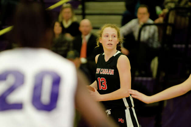 New Canaan's Liz Miller (13) controls the ball during the girls basketball game against Westhill at Westhill High School in Stamford on Tuesday, Feb. 12, 2013. Photo: Amy Mortensen / Connecticut Post Freelance