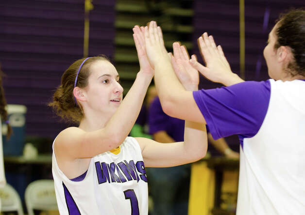 Westhill's Kat Grosso (1) high fives a teammate at the start of the girls basketball game against New Canaan at Westhill High School in Stamford on Tuesday, Feb. 12, 2013. Photo: Amy Mortensen / Connecticut Post Freelance