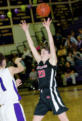 New Canaan's Georgia Hunsinger (23) defends against Westhill during the girls basketball game against Westhill at Westhill High School in Stamford on Tuesday, Feb. 12, 2013. Photo: Amy Mortensen / Connecticut Post Freelance