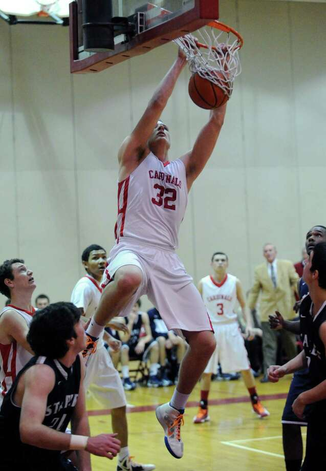 Alex Wolf # 32 of Greenwich dunks the ball during the boys high school basketball game between Greenwich High School and Staples High School at Greenwich, Tuesday, Feb. 12, 2013. Photo: Bob Luckey / Greenwich Time