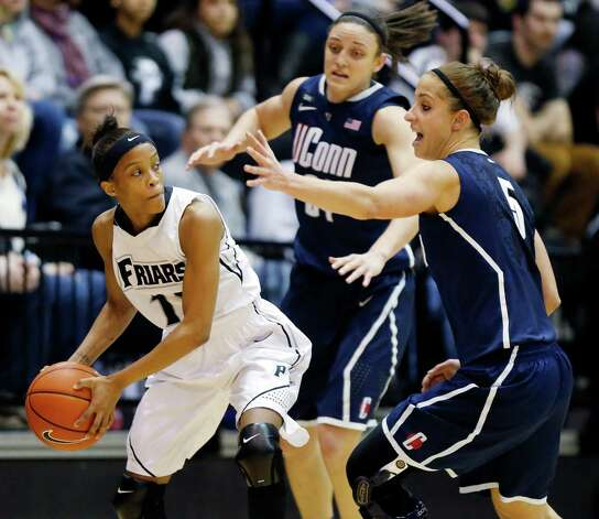 Providence's Symone Roberts (12) keeps the ball away from Connecticut's Kelly Faris, center, and Caroline Doty (5) in the first half of an NCAA college basketball game in Providence, R.I., Tuesday, Feb. 12, 2013. (AP Photo/Michael Dwyer) Photo: Michael Dwyer, Associated Press / AP