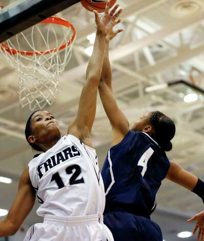 Providence's Symone Roberts (12) blocks a shot by Connecticut's Moriah Jefferson (4) in the first half of an NCAA college basketball game in Providence, R.I., Tuesday, Feb. 12, 2013. (AP Photo/Michael Dwyer) Photo: Michael Dwyer, Associated Press / AP