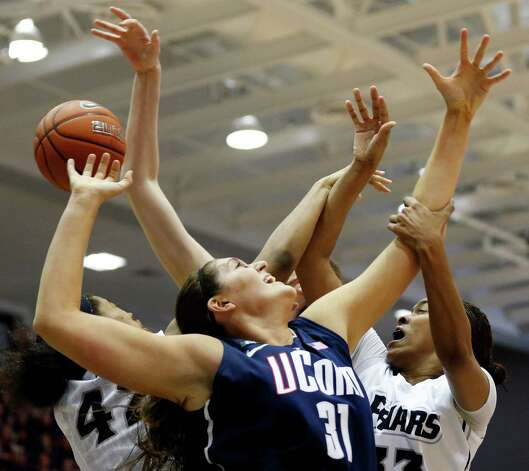 Connecticut's Stefanie Dolson (31) battles Providence's Alexis Harris (42) and Brianna Edwards (33) for a rebound in the first half of an NCAA college basketball game in Providence, R.I., Tuesday, Feb. 12, 2013. (AP Photo/Michael Dwyer) Photo: Michael Dwyer, Associated Press / AP