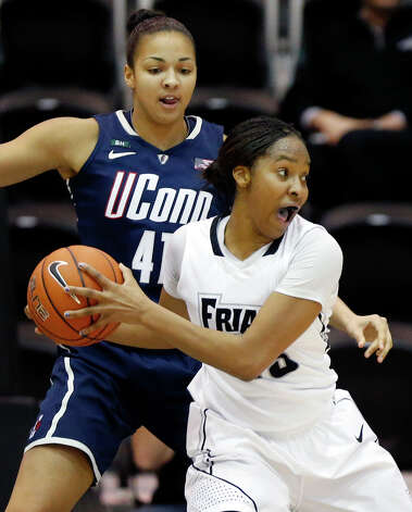 Providence's Brianna Edwards, right, looks to pass in front of Connecticut's Kiah Stokes (41) in the first half of an NCAA college basketball game in Providence, R.I., Tuesday, Feb. 12, 2013. (AP Photo/Michael Dwyer) Photo: Michael Dwyer, Associated Press / AP