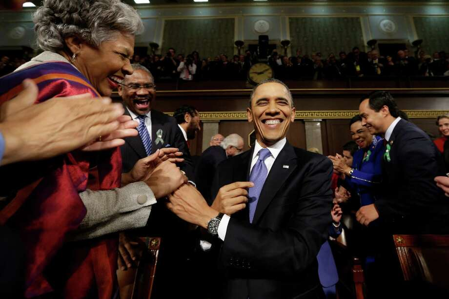 President Barack Obama is greeted before his State of the Union address during a joint session of Congress on Capitol Hill in Washington, Tuesday Feb. 12, 2013. (AP Photo/Charles Dharapak, Pool) Photo: Charles Dharapak, Associated Press / AP Pool
