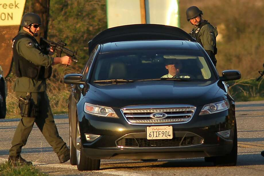 San Bernardino County sheriff's deputies search a vehicle leaving the Big Bear Lake area during a gunbattle believed to be with suspect Christopher Dorner. Photo: David Mcnew, AFP/Getty Images