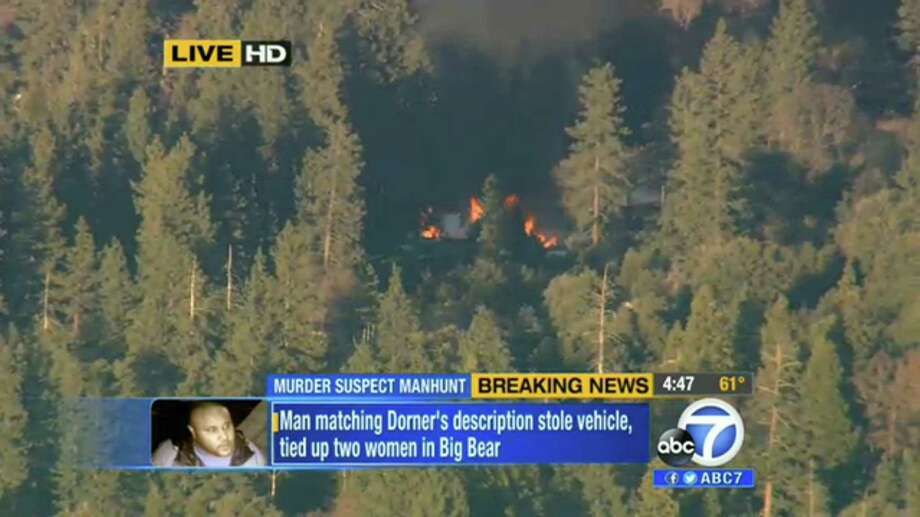 The cabin in Big Bear, Calif., where former Los Angeles police officer Christopher Dorner is believed to have barricaded himself is shown erupting in flames Tuesday in this video grab taken from a news helicopter. Photo: Uncredited, TEL / KABC-TV