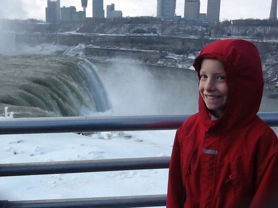 "Joyce Morier's grandson Fred enjoys seeing Niagara Falls for the first time during a trip in the Buffalo area for a family wedding. ""It was sunny, but an exceptionally cold day. My grandson is from a warmer climate and was really cold,"" she says. (Joyce Morier)"