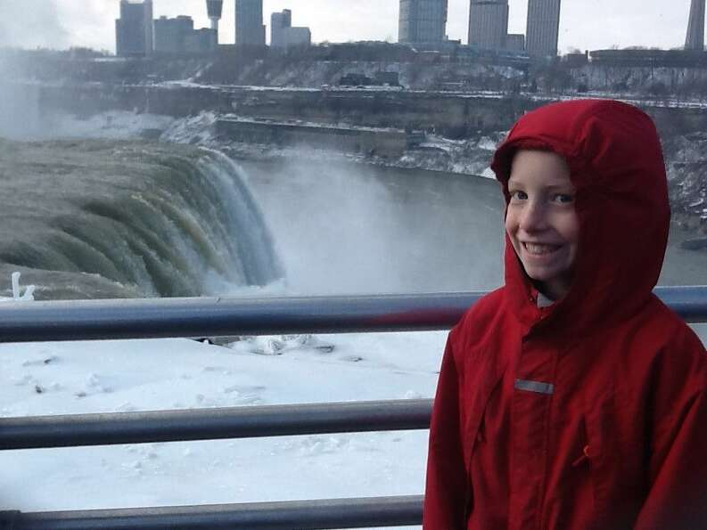 Joyce Morier's grandson Fred enjoys seeing Niagara Falls for the first time during a trip in the Buf