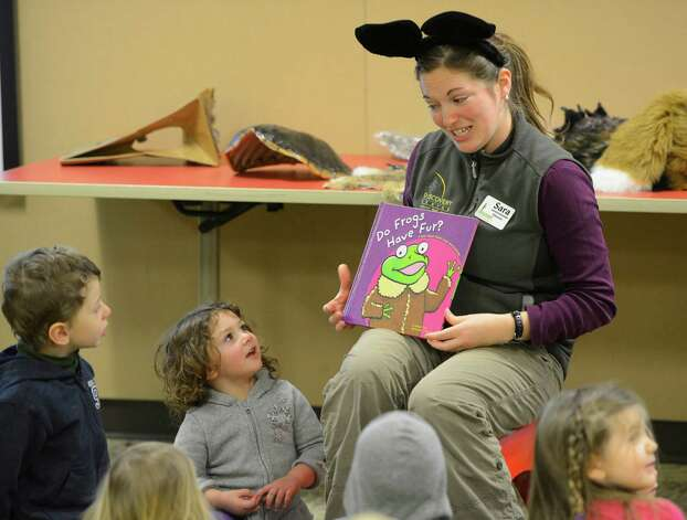 "Environmental educator Sara Poggi reads ""Do Frogs Have Fur"" to her pre-K students Feb. 12, 2013, at the Pine Bush Discovery Center in Albany, N.Y.  The Pre-K program teaches how our native animals survive the long, cold winters in this region.    (Skip Dickstein/Times Union) Photo: SKIP DICKSTEIN / 00021129A"