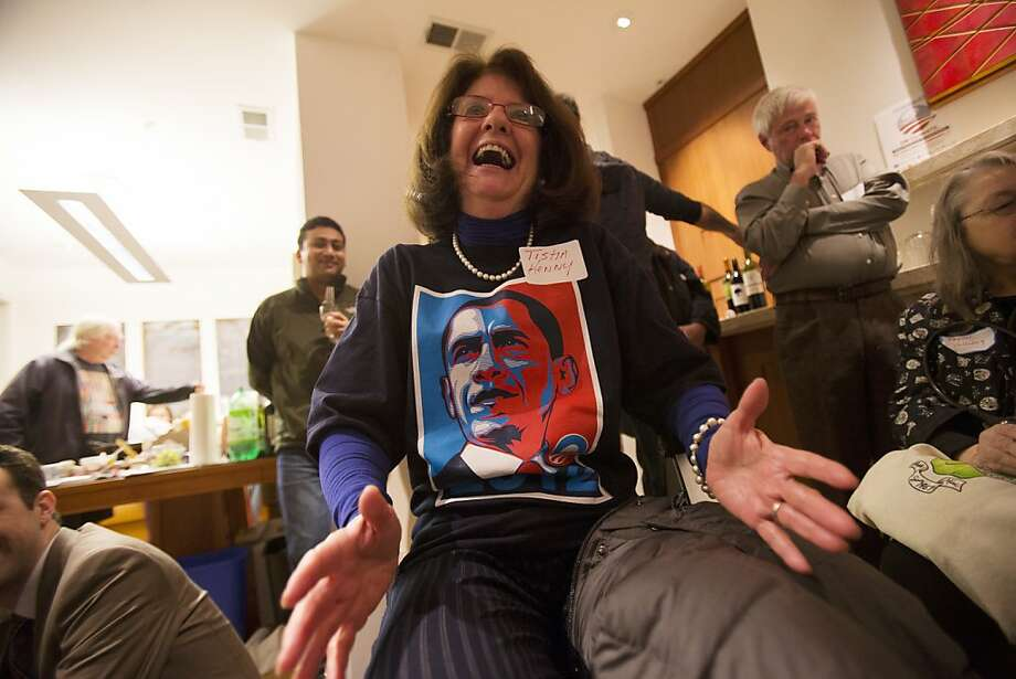 Tisha Kenny of S.F. cheers President Obama's speech during a watch party at a Church Street home. Photo: Stephen Lam, Special To The Chronicle