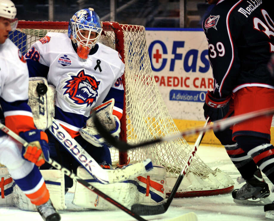 Sound Tigers goalie Kevin Poulin deflects a Springfield shot, during hockey action at the Webster Bank Arena in Bridgeport, Conn. on Tuesday February 12, 2013. Photo: Christian Abraham / Connecticut Post