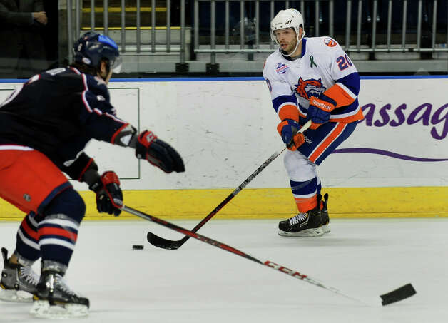 Sound Tigers #20 Blair Riley moves the puck, during hockey action against Springfield at the Webster Bank Arena in Bridgeport, Conn. on Tuesday February 12, 2013. Photo: Christian Abraham / Connecticut Post