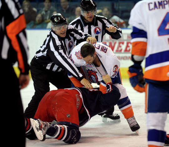 Sound Tigers #20 Blair Riley fights with Springfield's #14 Jake Hansen, during hockey action at the Webster Bank Arena in Bridgeport, Conn. on Tuesday February 12, 2013. Photo: Christian Abraham / Connecticut Post