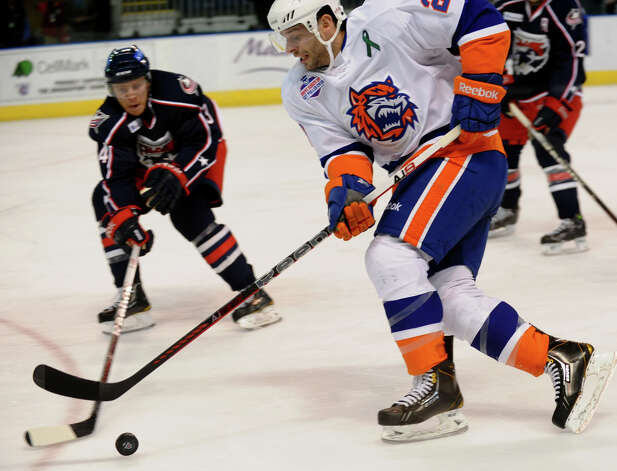 Sound Tigers #20 Blair Riley moves the puck as Springfield's #34 Mike Banwell intercepts, during hockey action at the Webster Bank Arena in Bridgeport, Conn. on Tuesday February 12, 2013. Photo: Christian Abraham / Connecticut Post