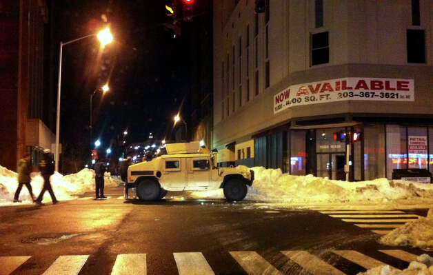 The National Guard is on duty after the weekend blizzard on Fairfield Avenue and Main Street in Bridgeport, Conn. on Tuesday February 12, 2013. Photo: Christian Abraham / Connecticut Post