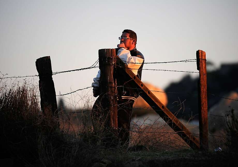 YUCAIPA, CA - FEBRUARY 12:  A resident of Redlands looks at a police blockade during a manhunt for the former Los Angeles Police Department officer Christopher Dorner, who is suspected of triple murder, on February 12, 2013 in Yucaipa, California. Dorner barricaded himself in a cabin near Big Bear, California and is in a standoff with authorities after shooting two police officers, killing one and wounding the other. Dorner, a former Los Angeles Police Department officer and Navy Reserve veteran, is wanted in connection with the deaths of an Irvine couple and a Riverside police officer.  (Photo by Kevork Djansezian/Getty Images) Photo: Kevork Djansezian, Getty Images
