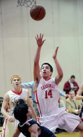 Thomas Baietto # 14 of Greenwich scores during the boys high school basketball game between Greenwich High School and Staples High School at Greenwich, Tuesday, Feb. 12, 2013. Photo: Bob Luckey / Greenwich Time