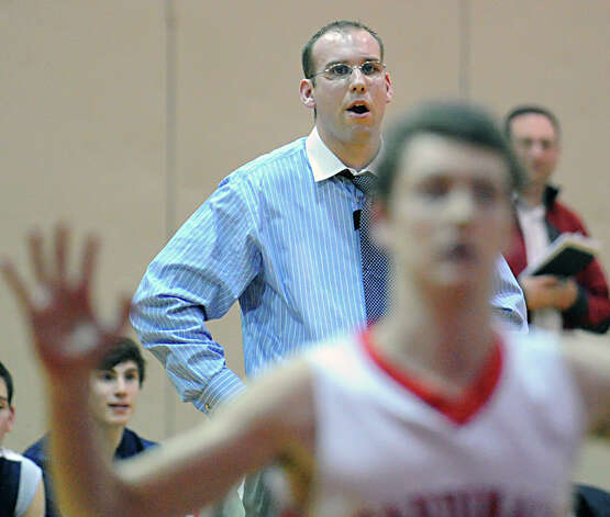 Staples coach Colin Devine during the boys high school basketball game between Greenwich High School and Staples High School at Greenwich, Tuesday, Feb. 12, 2013. Photo: Bob Luckey / Greenwich Time