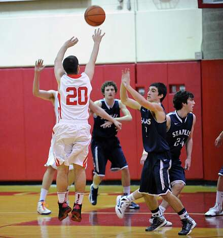 Jimmy Djema # 20 of Greenwich shoots during the boys high school basketball game between Greenwich High School and Staples High School at Greenwich, Tuesday, Feb. 12, 2013. Photo: Bob Luckey / Greenwich Time
