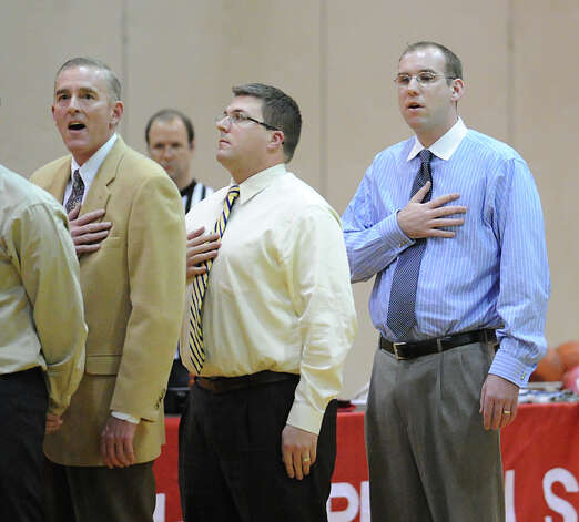 The Staples coaching staff during the National Anthem with head coah Colin Devine, right, during the boys high school basketball game between Greenwich High School and Staples High School at Greenwich, Tuesday, Feb. 12, 2013. Photo: Bob Luckey / Greenwich Time