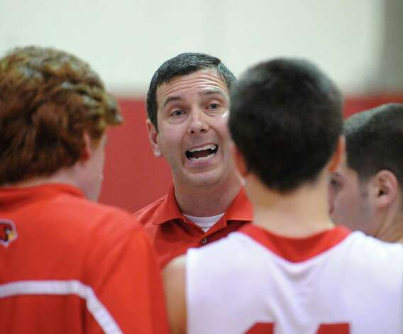 Greenwich boys basketball coach Bill Brehm huddles with his team during the boys high school basketball game between Greenwich High School and Staples High School at Greenwich, Tuesday, Feb. 12, 2013. Photo: Bob Luckey / Greenwich Time
