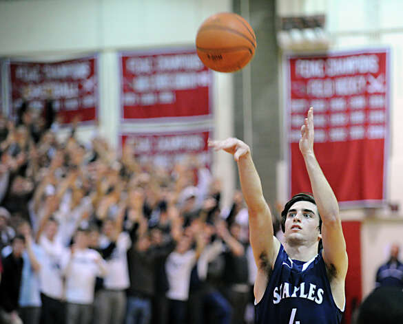 James Frusciante # 4 of Staples shoots a foul shot during the boys high school basketball game between Greenwich High School and Staples High School at Greenwich, Tuesday, Feb. 12, 2013. Photo: Bob Luckey / Greenwich Time