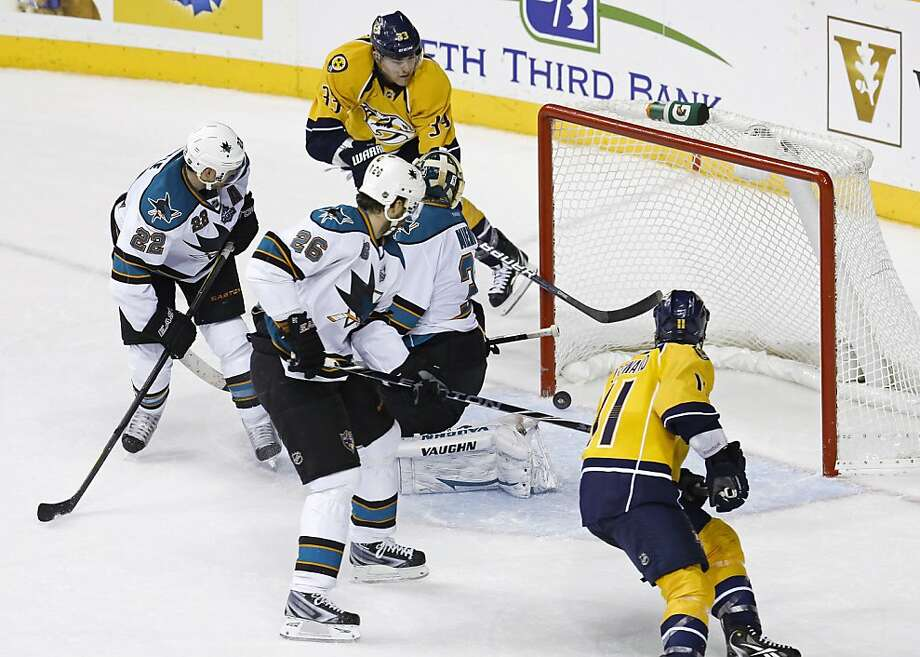 Predators center Colin Wilson (rear) scores against Sharks goaltender Antti Niemi in the overtime period. Photo: Mark Humphrey, Associated Press