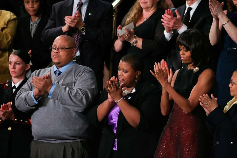 From second left: Nathaniel Pendleton and Cleopatra Cowley-Pendleton, the parents of Hadiya Pendleton, the 15-year-old who was killed in a shooting last month after performing in President Barack Obama's second inauguration, and Michelle Obama applaud as President Obama talks about a vote on gun violence in the House Chamber of the U.S. Capitol during his State of the Union address, in Washington, Feb. 12, 2013.The first State of the Union speech of President Obama's second term advances an expansive agenda focused on the economy and jobs, according to summaries provided to reporters. Photo: DOUG MILLS, New York Times / NYTNS