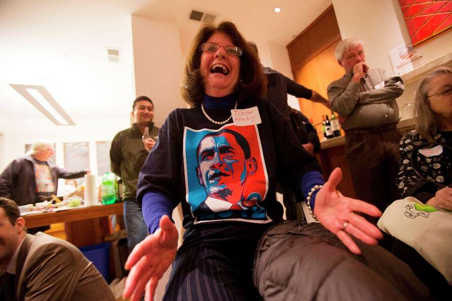 Tisha Kenny, of San Francisco, reacts during a State of the Union watch party for President Obama's