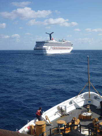 About 30 local Jazzercise enthusiasts and a dozen Churchill High alumni celebrating a bachelor party are stuck aboard the Carnival Triumph cruise ship. It was disabled by an engine room fire Sunday, leaving 4,200 people stranded in the Gulf of Mexico. Photo: Paul McConnell / U.S. Coast Guard Via Getty Images