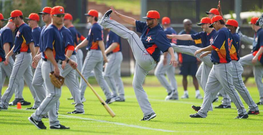 There were some kinks to work out as the Astros held the first formal workout of spring training on Tuesday. Photo: Karen Warren, MBO / Houston Chronicle