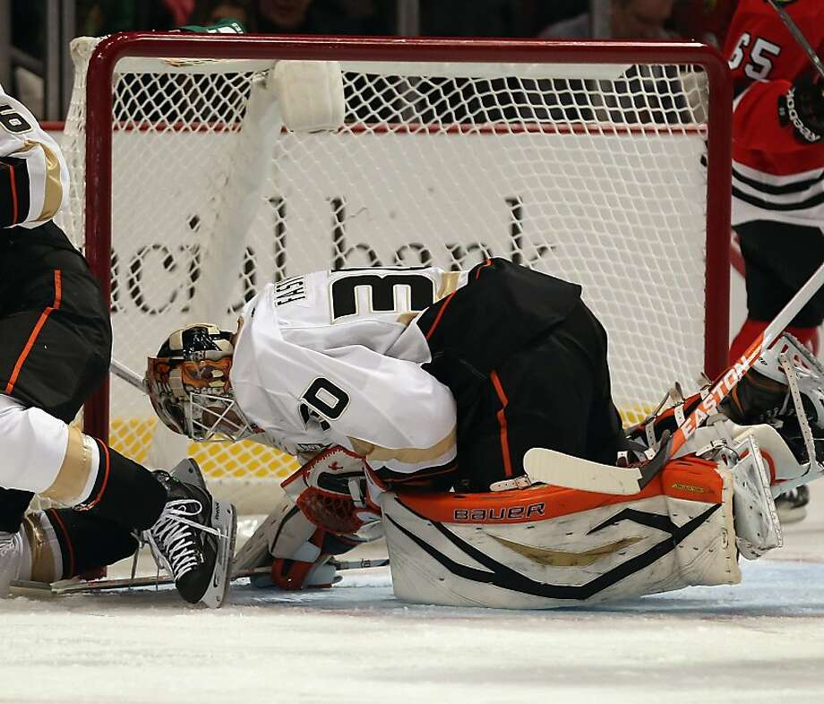 Anaheim's rookie goaltender, Viktor Fasth of Sweden, makes one of his 28 saves against the Blackhawks. Photo: Jonathan Daniel, Getty Images