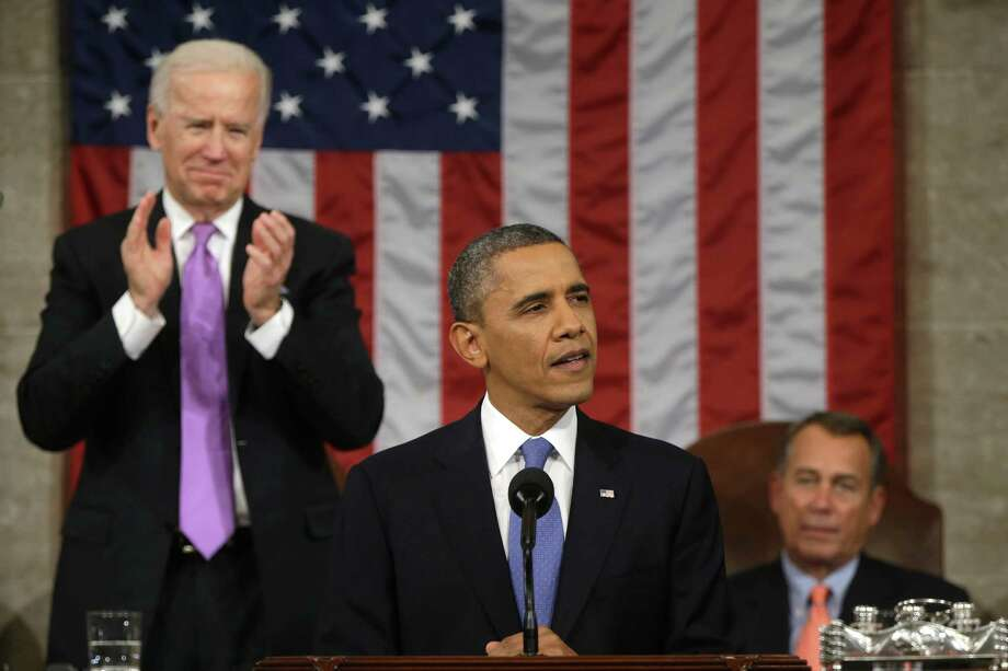 WASHINGTON, DC - FEBRUARY 12:  U.S. Vice President Joe Biden (L) applauds as U.S. President Barack Obama gives his State of the Union address during a joint session of Congress at the U.S. Capitol February 12, 2013 in Washington, DC. Facing a divided Congress, Obama focused his speech on new initiatives designed to stimulate the U.S. economy. (Photo by Charles Dharapak-Pool/Getty Images) Photo: Pool