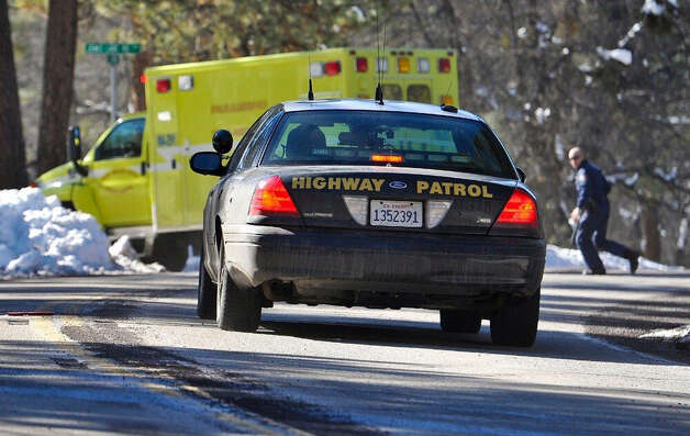 Law enforcement officials respond after Christopher Dorner, the fugitive ex-Los Angeles cop sought in three killings, engaged in a shootout with authorities that wounded two officers in the San Bernardino Mountains near Big Bear Lake, Calif., Tuesday, Feb. 12, 2013. (AP Photo/The Sun, Rachel Luna) VENTURA COUNTY STAR OUT; RIVERSIDE PRESS-ENTERPRISE OUT; THE VICTOR VALLEY DAILY PRESS OUT Photo: Rachel Luna