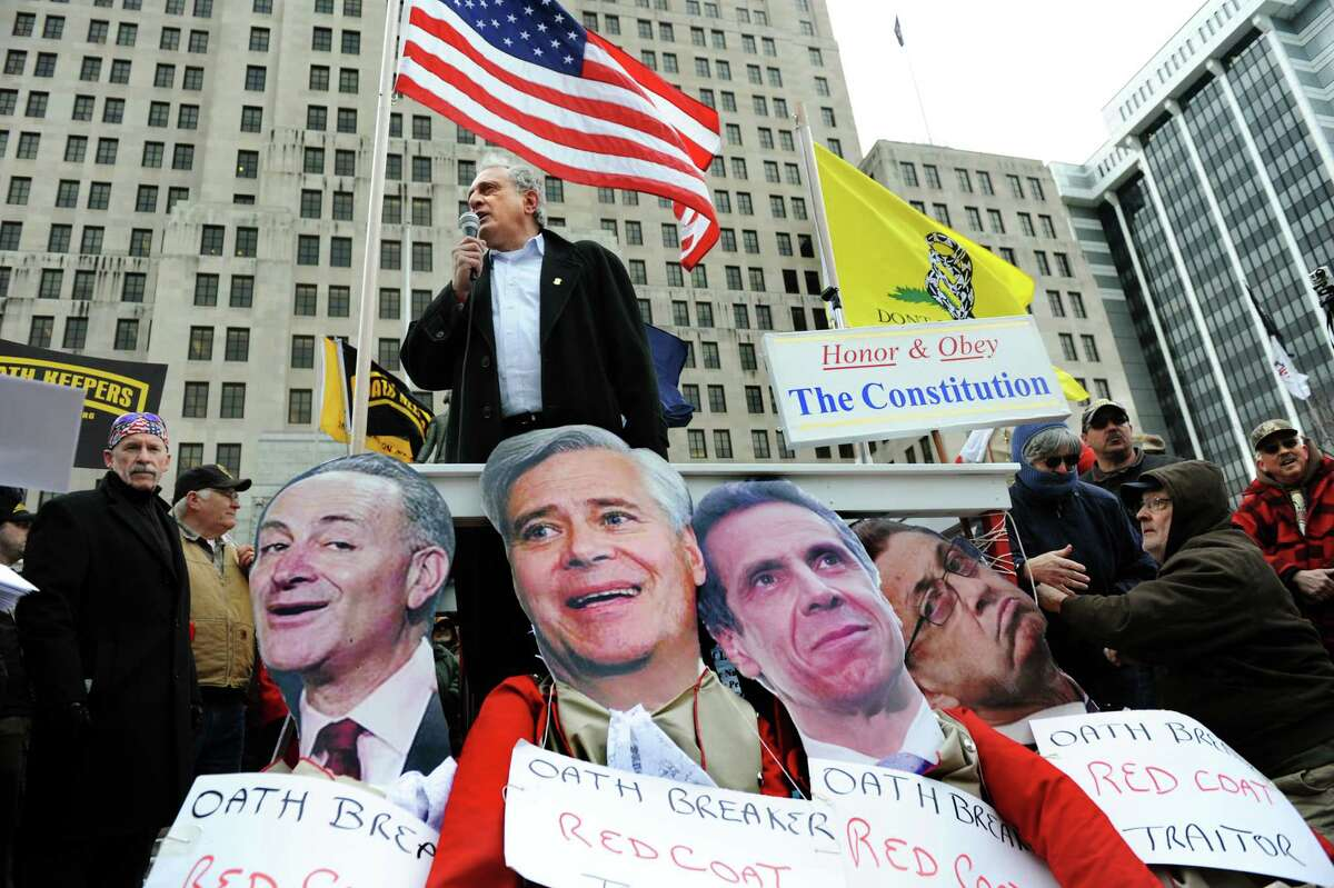 Carl Paladino, center, joins Second Amendment advocates as they rally against the SAFE Act on Tuesday, Feb. 12, 2013, at the Capitol in Albany', N.Y. (Cindy Schultz / Times Union)