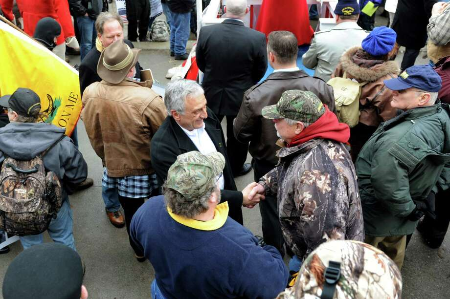 Carl Paladino, center, joins Second Amendment advocates as they rally against the SAFE Act on Tuesday, Feb. 12, 2013, at the Capitol in Albany', N.Y. (Cindy Schultz / Times Union) Photo: Cindy Schultz / 00021126A