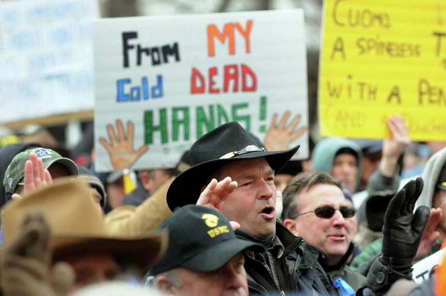 Gregory Chaplain of Greenfield Center, center, takes the OATH Keepers oath with other Second Amendment advocates as they rally against the SAFE Act on Tuesday, Feb. 12, 2013, at the Capitol in Albany', N.Y. (Cindy Schultz / Times Union) Photo: Cindy Schultz / 00021126A