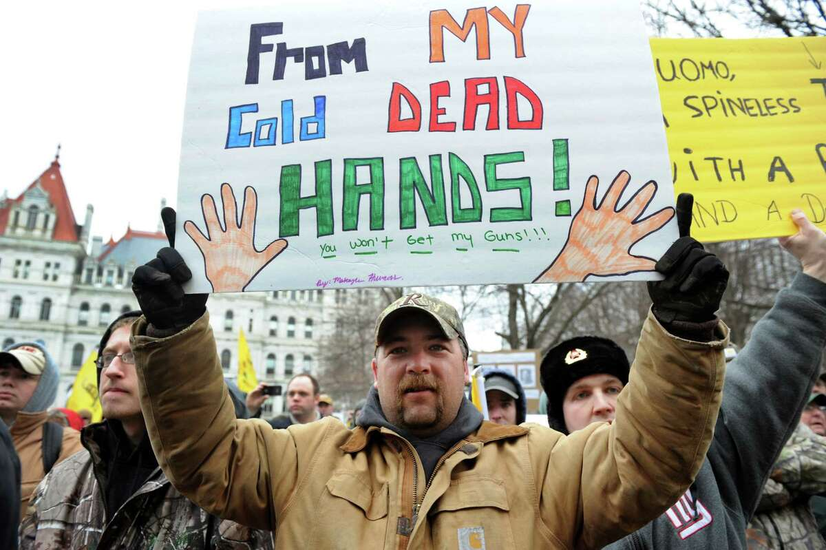 Bill Hillicoss of Durham, center, rallies with other Second Amendment advocates against the SAFE Act on Tuesday, Feb. 12, 2013, at the Capitol in Albany', N.Y. (Cindy Schultz / Times Union)