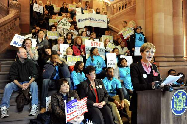Kim Russell of Brooklyn, right, speaks as she joins gun control advocates showing their support for the SAFE Act on Tuesday, Feb. 12, 2013, at the Capitol in Albany', N.Y. One Million Moms For Gun Control organized the event held on the Million Dollar Staircase. (Cindy Schultz / Times Union) Photo: Cindy Schultz / 00021126A