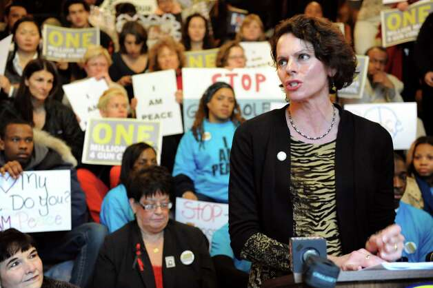 Assemblywoman Patricia Fahey, right, joins gun control advocates as they show their support for the SAFE Act on Tuesday, Feb. 12, 2013, at the Capitol in Albany', N.Y. One Million Moms For Gun Control organized the event held on the Million Dollar Staircase. (Cindy Schultz / Times Union) Photo: Cindy Schultz / 00021126A