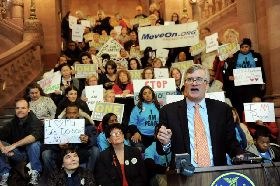 Assemblyman Brian Kavanagh, right, joins gun control advocates as they show their support for the SAFE Act on Tuesday, Feb. 12, 2013, at the Capitol in Albany, N.Y. One Million Moms For Gun Control organized the event held on the Million Dollar Staircase. (Cindy Schultz / Times Union) Photo: Cindy Schultz / 00021126A